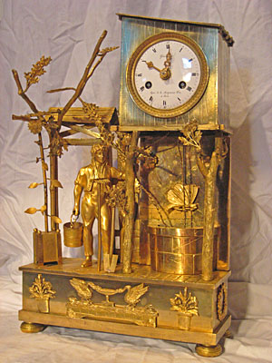 Fine brass French mantel clock with unusual butterfly pendulum, circa 1810