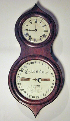 Eight day, spring powered Seth Thomas rosewood Office Calendar No. 3, better known as a Peanut clock