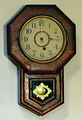 Oak miniature school clock made by the Ansonia Clock Company, Brooklyn, New York, circa 1885